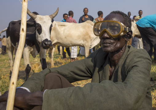 Nuer Tribe Man With A Diving Mask As Sunglasses In A  Market, Gambela, Ethiopia