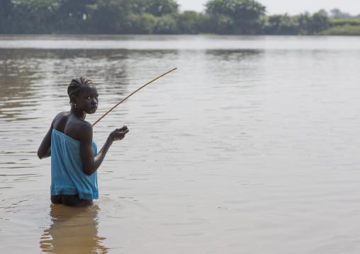 Anuak Tribe Girl Fishing On Baro River, Gambela, Ethiopia