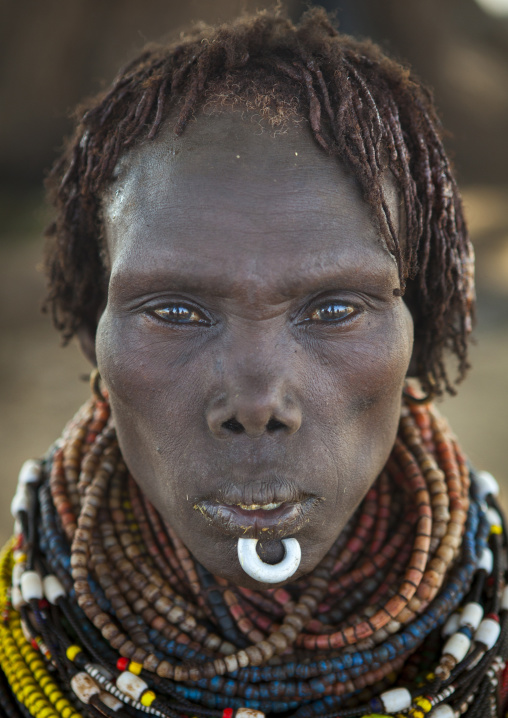Portrait Of A Nyangatom Tribe Woman With Chin Jewel, Omo Valley, Kangate, Ethiopia