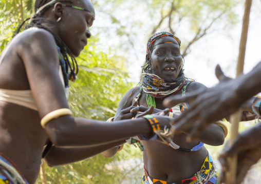 Woman From Anuak Tribe In Traditional Clothing Dancing, Gambela, Ethiopia