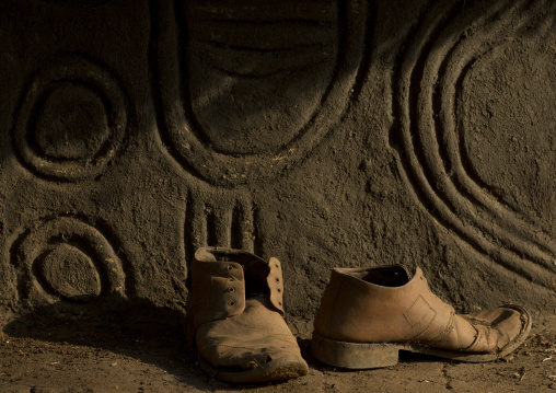Old Shoes In Front Of An Anuak Traditional Hut In Abobo, The Former Anuak King Village, Gambela Region, Ethiopia