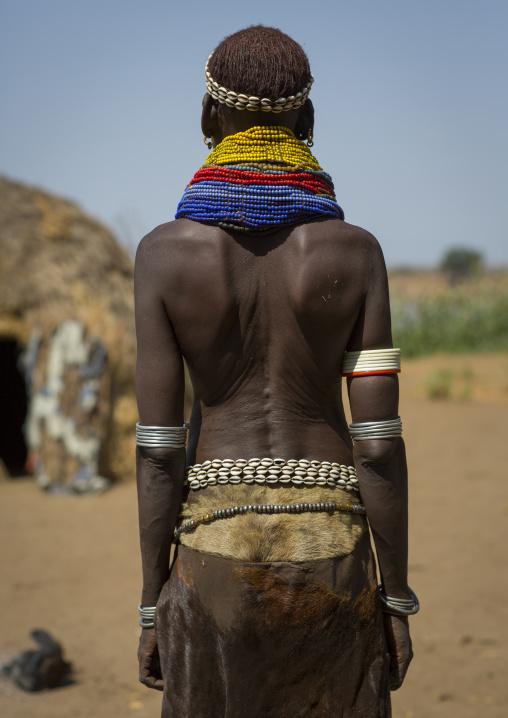 Portrait Of A Nyangatom Tribe Woman With Traditional Skirt, Omo Valley, Kangate, Ethiopia