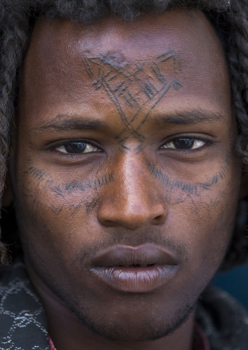 Afar Tribe Man With Curly Hair And Facial Tattoos, Assayta, Ethiopia