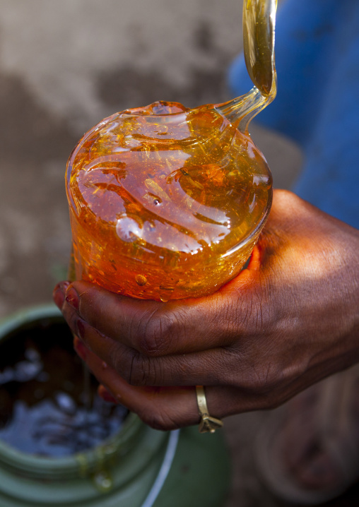 Woman Holding A Pot Of Honey In A Market, Metahara, Ethiopia