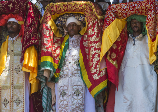 Priests Carrying Some Covered Tabots On Their Heads During Timkat Epiphany Festival, Lalibela, Ethiopia