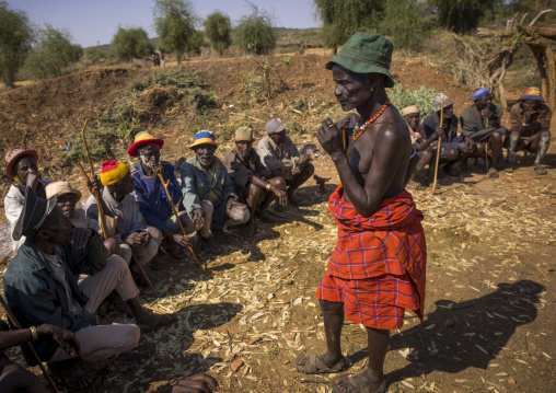 Men Negociating During A Mourning Ceremony To Know How Many Cows Will Be Killed In Hamer Tribe, Turmi, Omo Valley, Ethiopia