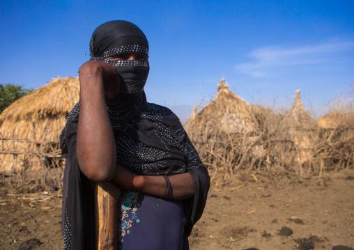 Portrait of an oromo woman with face covered, Amhara region, Artuma, Ethiopia
