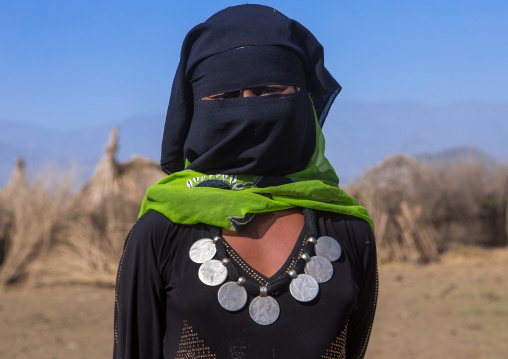 Portrait of an oromo woman with maria theresa thalers necklace, Amhara region, Artuma, Ethiopia