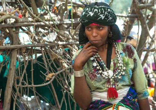 Oromo woman with silver maria theresa thalers necklace, Oromo, Sambate, Ethiopia