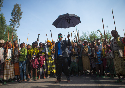 Oromo groom with an umbrella during his wedding celebration, Oromo, Sambate, Ethiopia