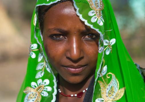 Portrait of an oromo woman with maria theresa thalers necklace, Oromo, Sambate, Ethiopia