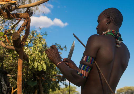 Hamer tribe whipper during a bull jumping ceremony, Omo valley, Turmi, Ethiopia