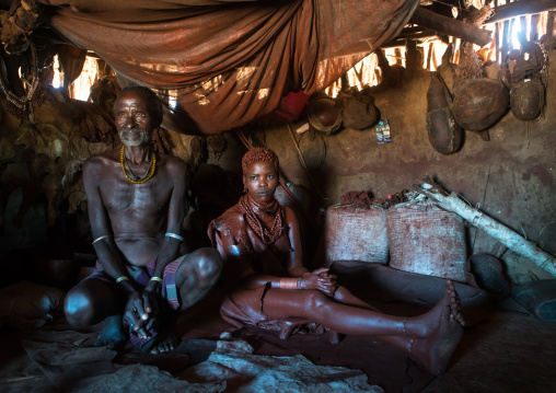 Hamer tribe teenage girl called a uta and her future stepfather who keeps her 6 months in a hut, Omo valley, Turmi, Ethiopia