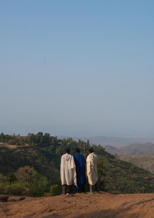 Ethiopian men walking along a hill, Amhara region, Lalibela, Ethiopia