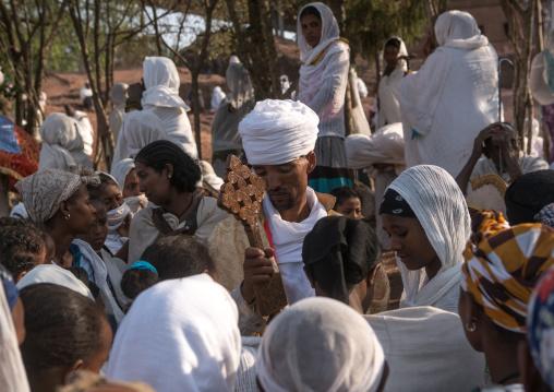 Priest blessing pilgrims during kidane mehret orthodox celebration, Amhara region, Lalibela, Ethiopia