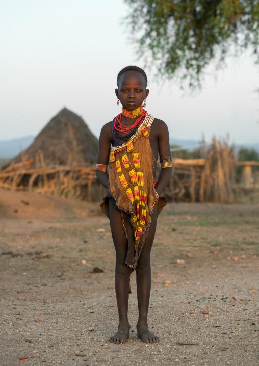 Portrait of a hamer tribe girl in traditional clothing, Omo valley, Turmi, Ethiopia