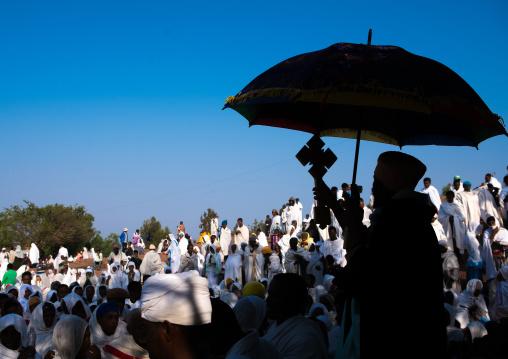 Silhouette of an ethiopian priest blessing the crowd during kidane mehret celebration, Amhara region, Lalibela, Ethiopia