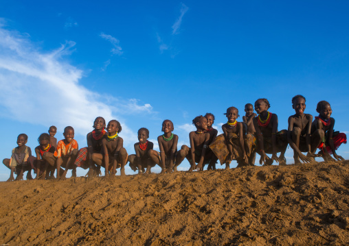 Dassanech tribe children dancing and jumping, Omo valley, Omorate, Ethiopia