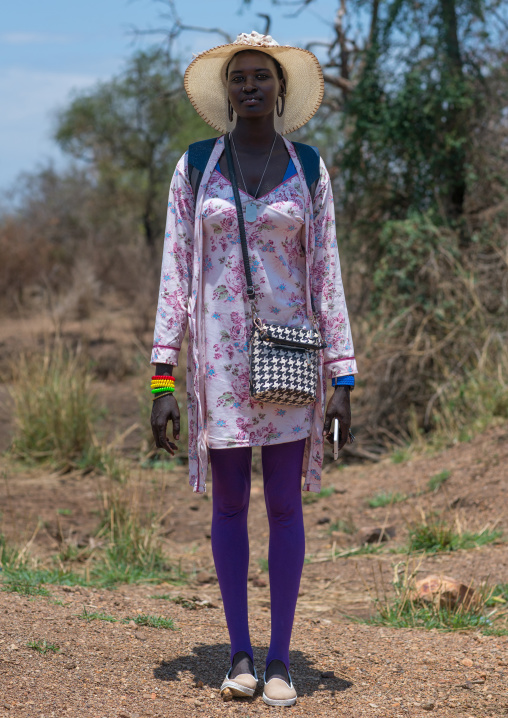 Young mursi tribe woman dressed in western clothes to go in town, Omo valley, Hana mursi, Ethiopia