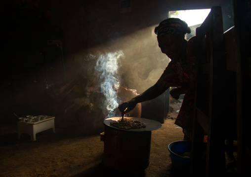 Ray of light in a house during a coffee ceremony, Omo valley, Jinka, Ethiopia