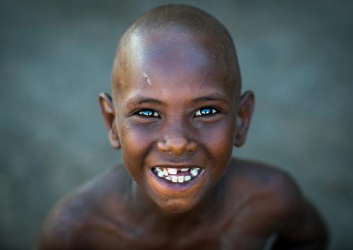 Smiling afar tribe boy with broken teeth, Afar region, Afambo, Ethiopia