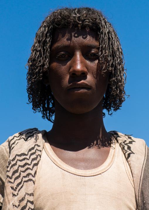 Portrait of an afar tribe man with traditional hairstyle, Afar region, Assayta, Ethiopia