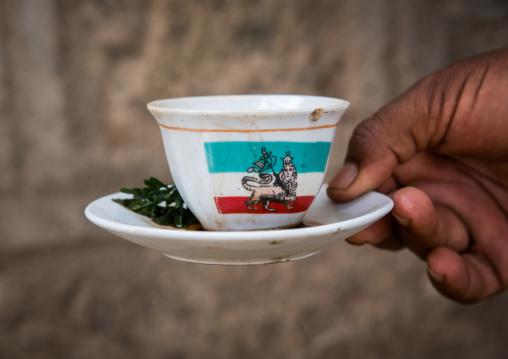 Cup of ethiopian coffee with lion of judah on it, Oromia, Metehara, Ethiopia