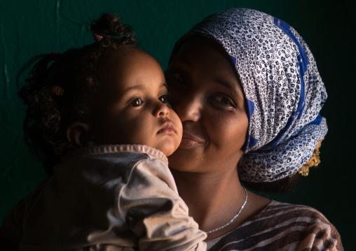 Sufi mother kissing her baby, Harari region, Harar, Ethiopia