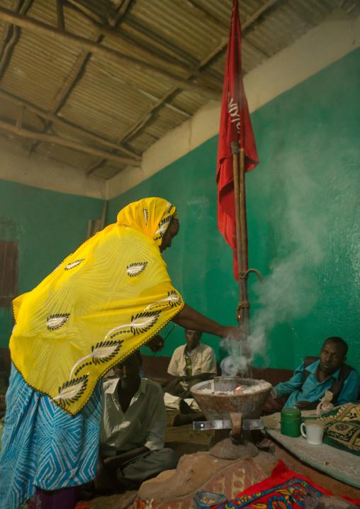 Woman burning insence during a sufi ceremony, Harari region, Harar, Ethiopia