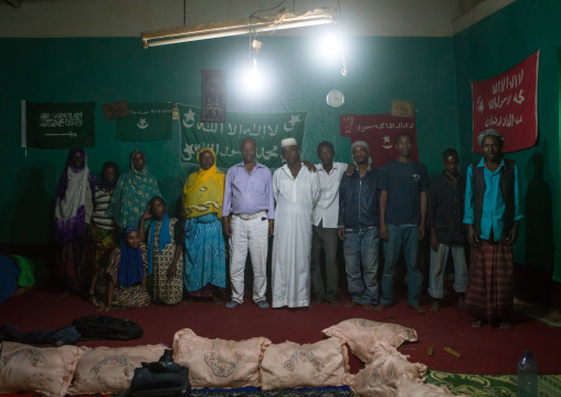 Sufi worshippers in front of islamic flags, Harari region, Harar, Ethiopia