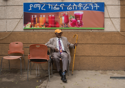 Ethiopia, Kembata, Alaba Kuito, old man in a suit sitting in a bar