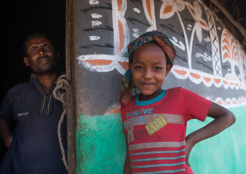 Ethiopia, Kembata, Alaba Kuito, father and daiughter standing in front of a traditional painted house