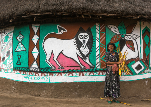 Ethiopia, Kembata, Alaba Kuito, ethiopian woman standing in front of her traditional painted house