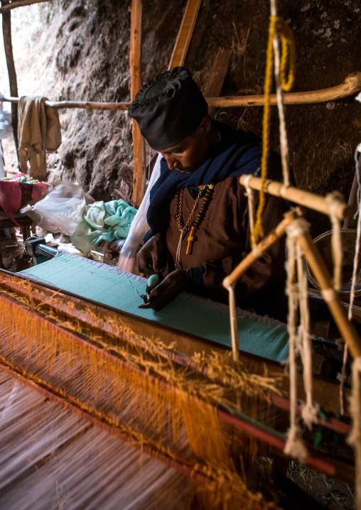 Orthodox monk weaver working, Amhara region, Lalibela, Ethiopia