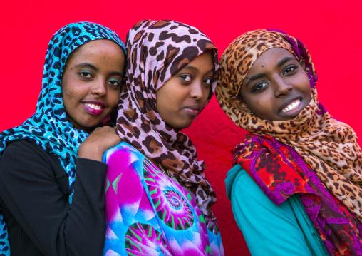 Three smiling veiled harari sisters, Harari Region, Harar, Ethiopia