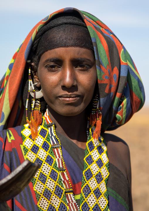 Portrait of an Issa tribe woman with a beaded necklace, Afar region, Yangudi Rassa National Park, Ethiopia