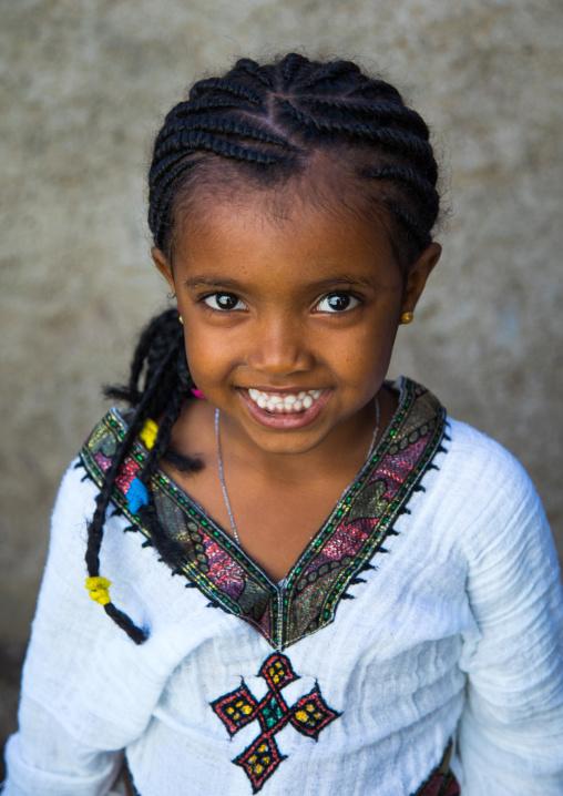 Portrait of an ethiopian child girl in traditional clothing, Afar region, Assaita, Ethiopia