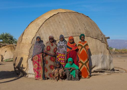Portrait of Afar tribe women in front of their traditional hut, Afar region, Afambo, Ethiopia