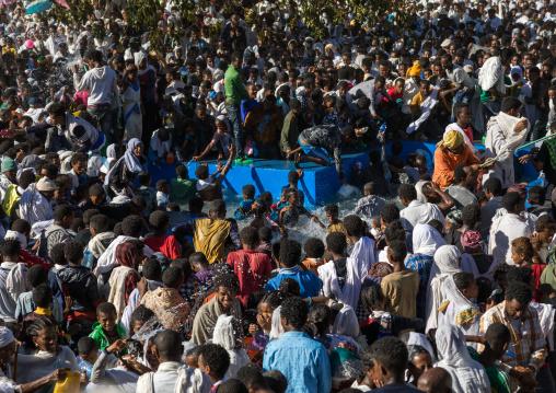 Holy water sprayed onto the crowd attending Timkat celebrations of epiphany, Amhara region, Lalibela, Ethiopia