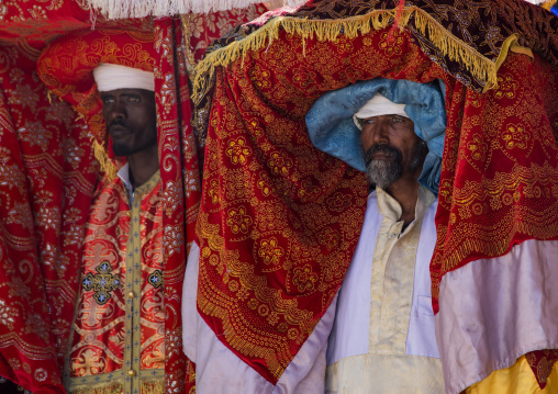 Ethiopian priests carrying some covered tabots on their heads during Timkat epiphany festival, Amhara region, Lalibela, Ethiopia
