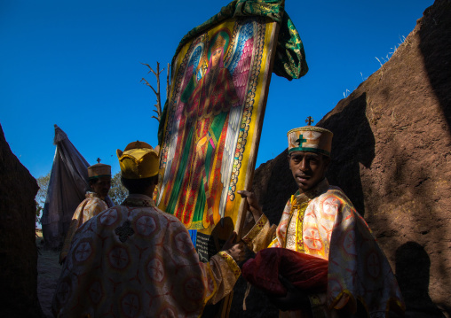 Monks taking out of Mariam rock church the flags for Timkat celebration, Amhara region, Lalibela, Ethiopia