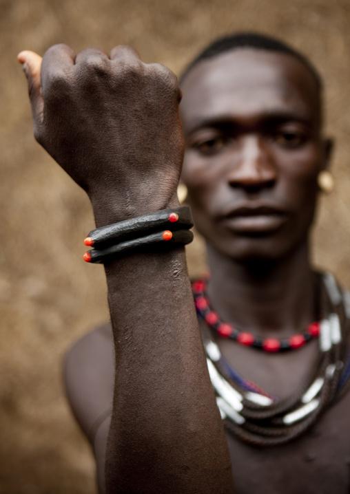 Menit man showing his bracelet at tum market, Omo valley, Ethiopia