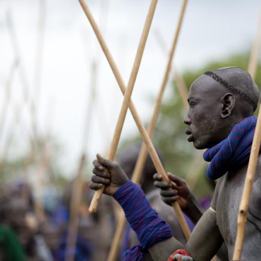 Suri tribe warriors fighting during a donga stick ritual, Omo valley, Tulgit, Ethiopia