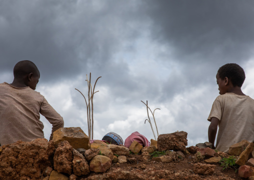 Oromo children selling forked stick oulle, Oromia, Sheik Hussein, Ethiopia