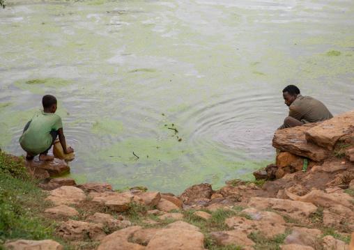 Holy water in a pound collected by oromo pilgrims, Oromia, Sheik Hussein, Ethiopia