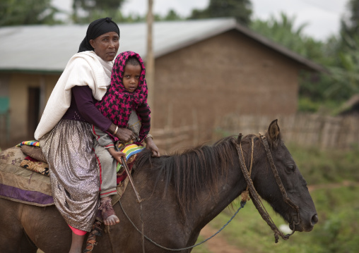 Mother and child on a horse, Ethiopia