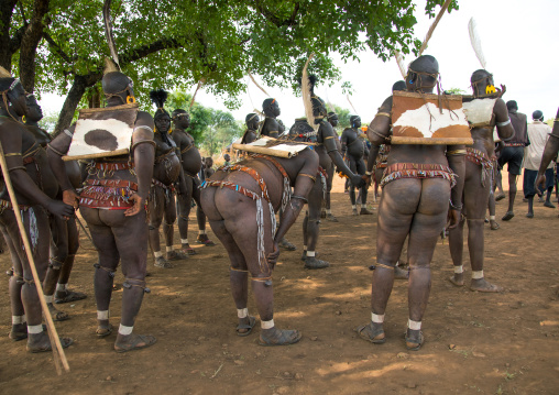 Bodi tribe fat men resting during Kael ceremony, Omo valley, Hana Mursi, Ethiopia
