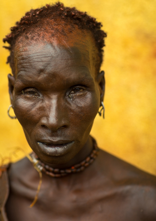Portrait of a Hamer tribe woman with red ochre on the face, Omo valley, Turmi, Ethiopia