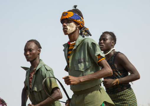 Men with weapons during the proud ox ceremony in the Dassanech tribe, Turkana County, Omorate, Ethiopia