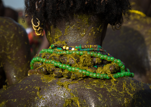 People covering themselves with cow dungs during the proud ox ceremony in the Dassanech tribe, Turkana County, Omorate, Ethiopia